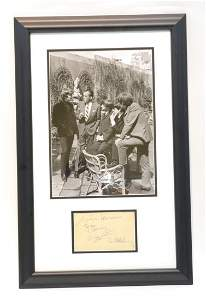 AUTOGRAPHED SHEET OF PAPER SIGNED BY ALL 4 BEATLES