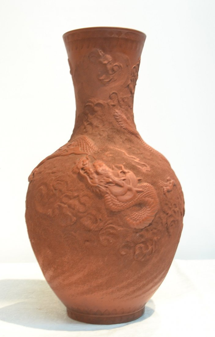 CHINESE TERRACOTTA VASE WITH RAISED DRAGONS