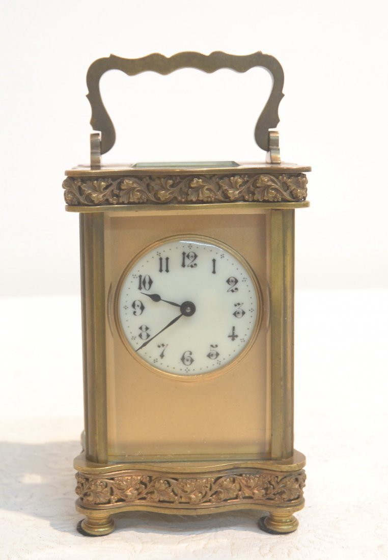 FRENCH BRONZE CARRIAGE CLOCK WITH  CARVED LEAVES