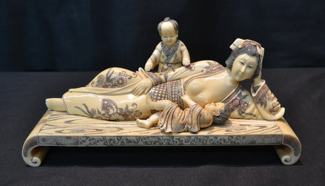 CARVED HIPPO RECLINING WOMAN WITH CHILDREN