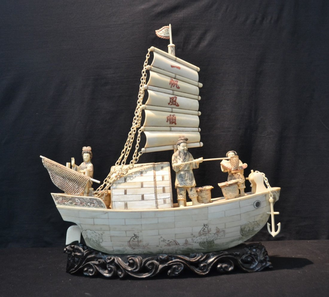LARGE CARVED BONE BOAT WITH FIGURES FISHING