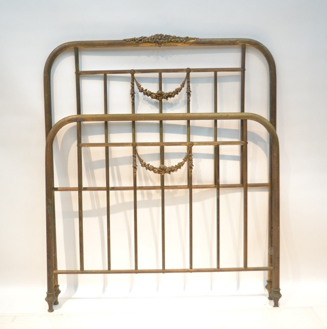BRASS SINGLE BED WITH FLORAL GARLANDS