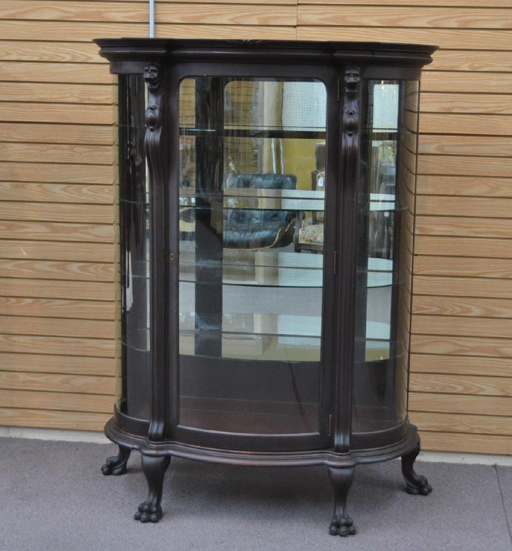 CARVED MAHOGANY CURVED FRONT CHINA CABINET