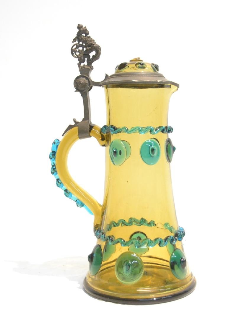 GLASS & PEWTER EWER WITH RAISED DECORATIONS