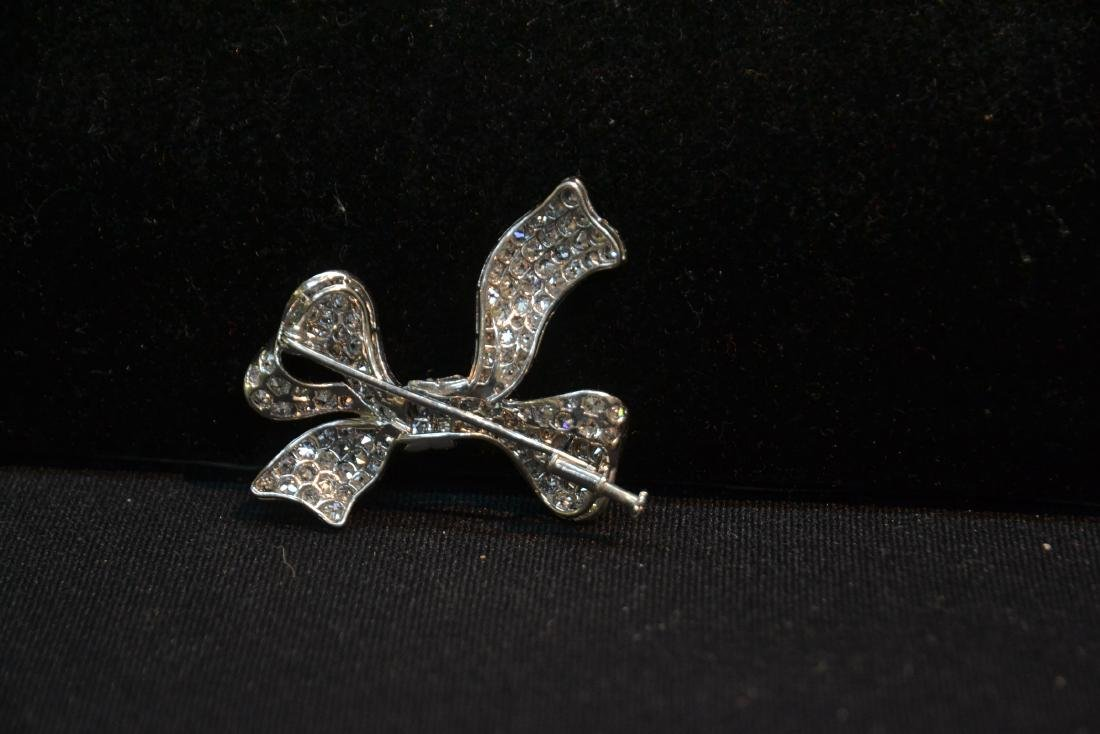 18kt WHITE GOLD APPROX. 3ctw DIAMOND BOW PIN - 7