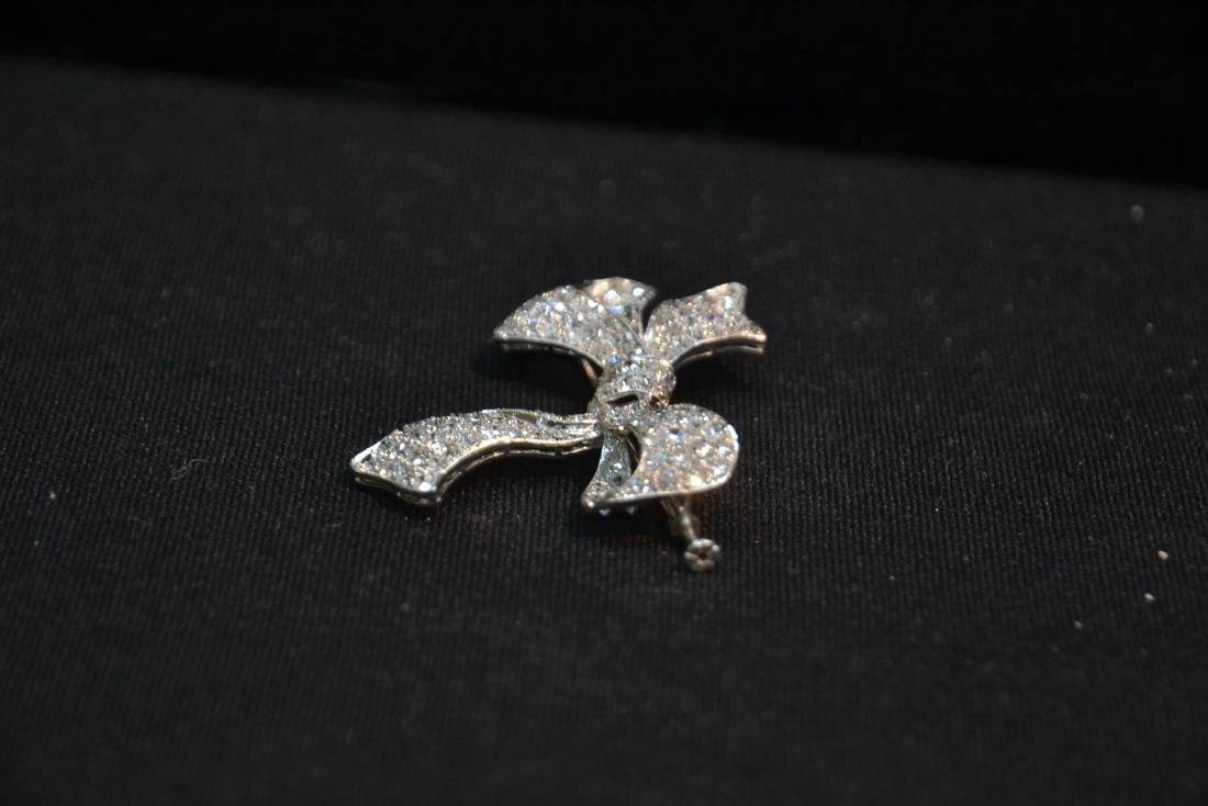 18kt WHITE GOLD APPROX. 3ctw DIAMOND BOW PIN - 8