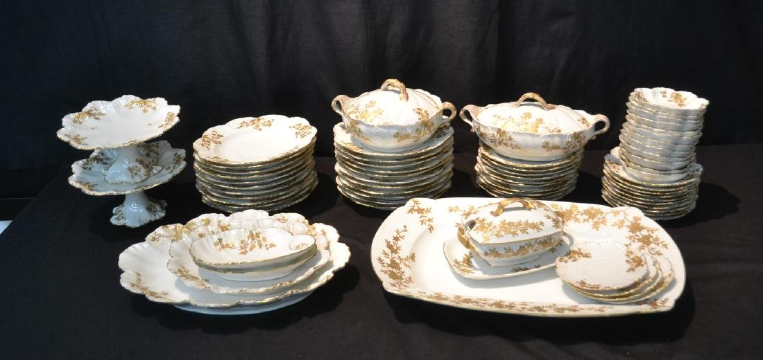 LIMOGES DINNER SERVICE WITH GOLD DECORATIONS