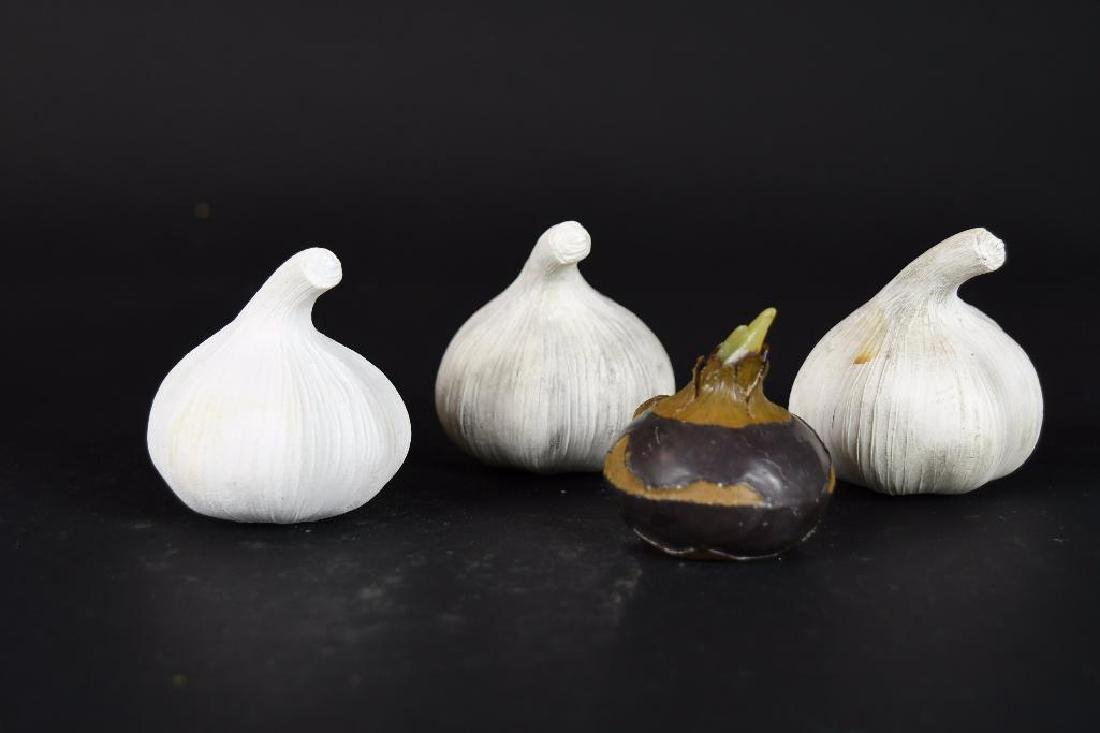 Four  Chinese Carved Agate Garlic Form Items