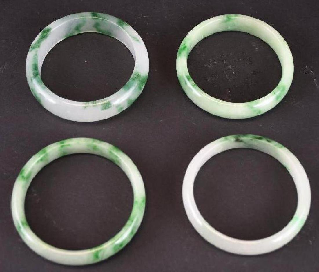 Four Mottled Green Jadeite Bangles