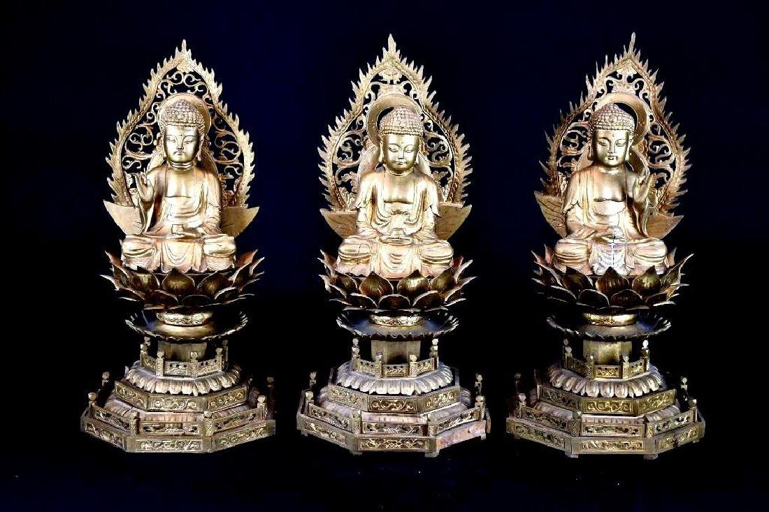 Three Chinese Gilt Carved Wood seated Buddha