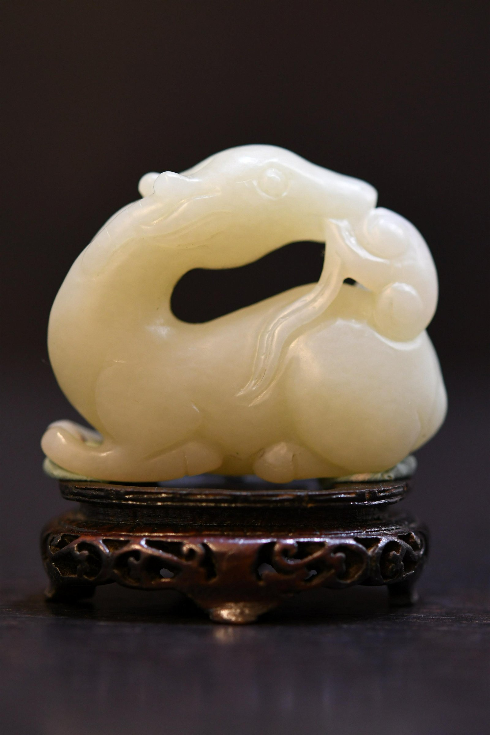 Carved White Jade seated horse with ruyi scepter