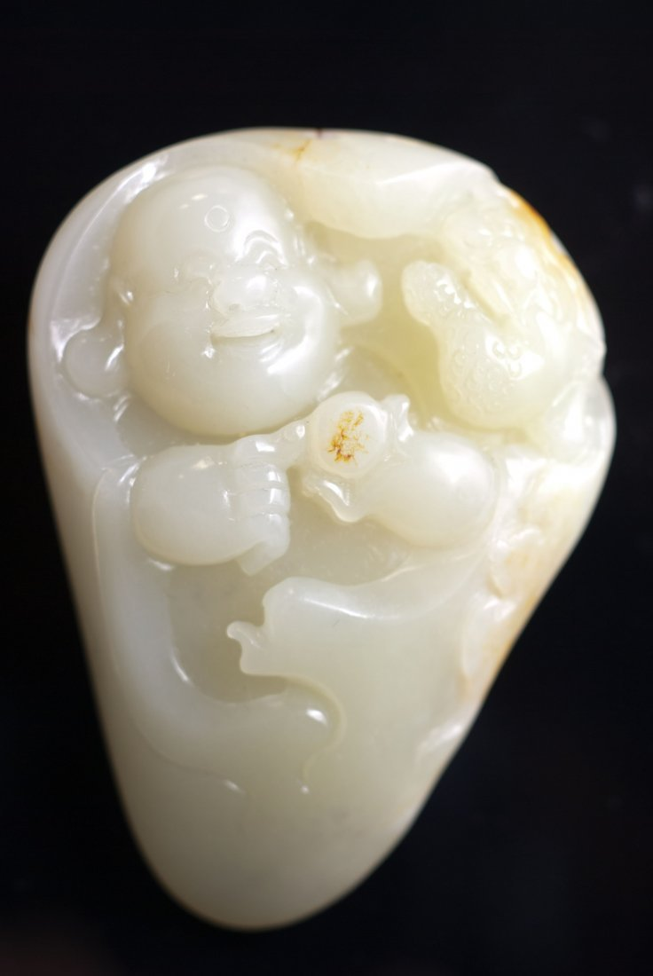 12: Carved White Jade Pebble of Boy with GIA