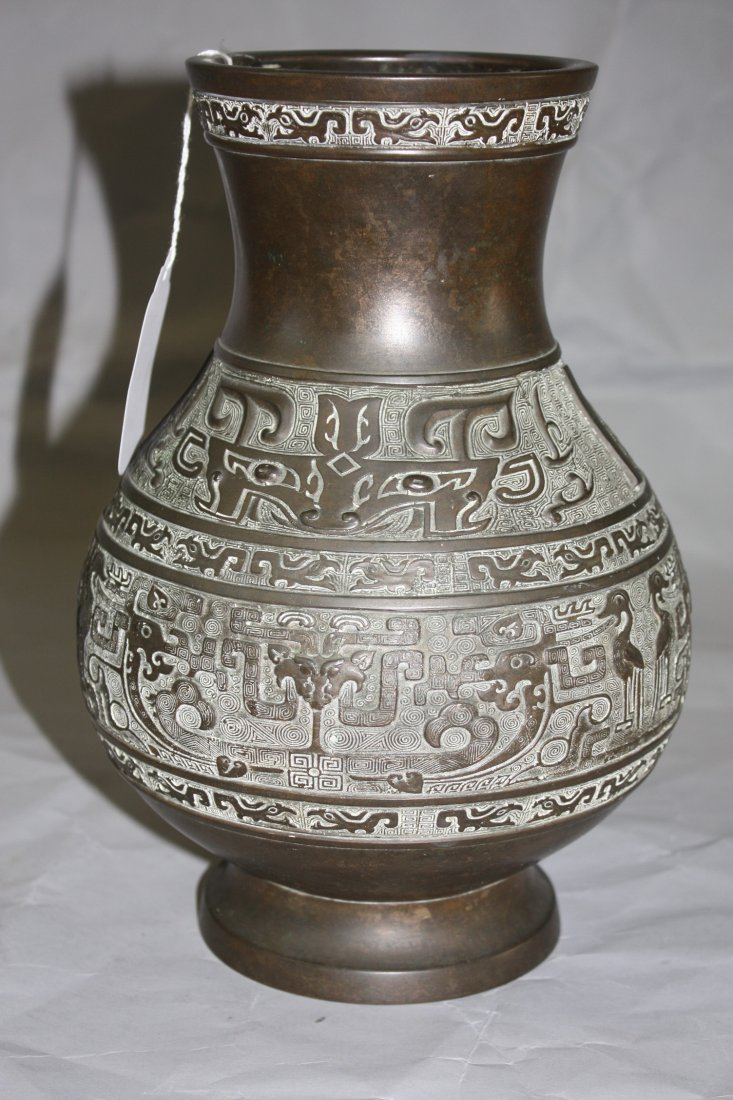 14: Antique Chinese Bronze Vase with Mask Design