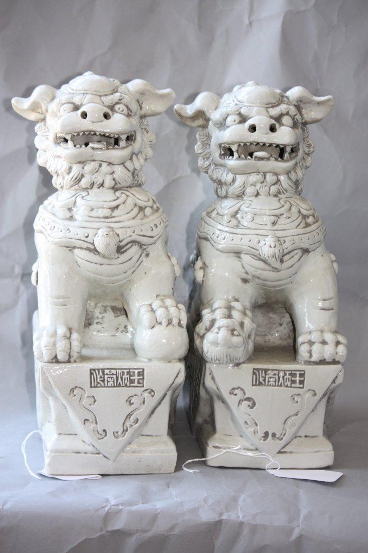 23: Pair of Blanc de Chine Porcelain White Foo Dogs