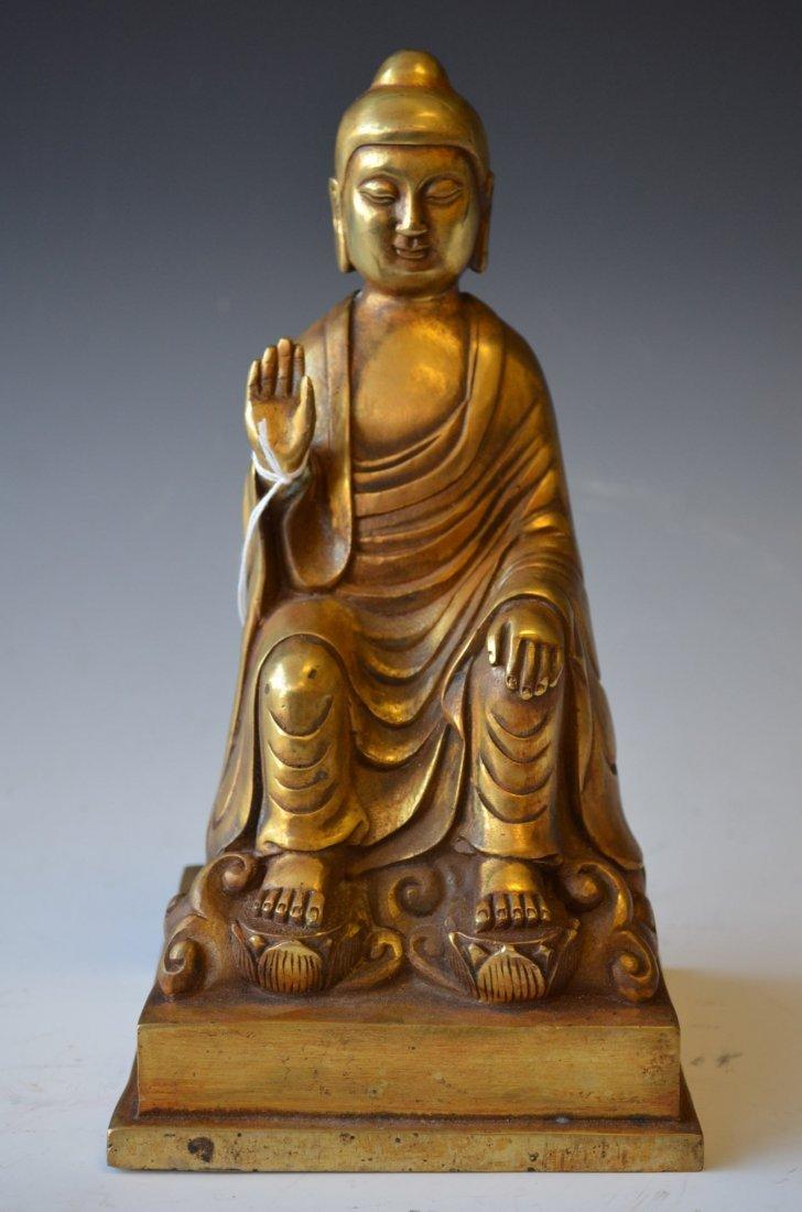4: A Bronze Seated Buddha