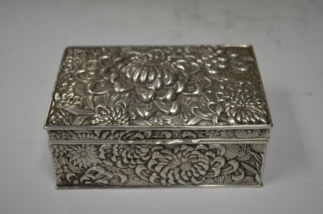 A Rectangular Floral Decorated Silver Box