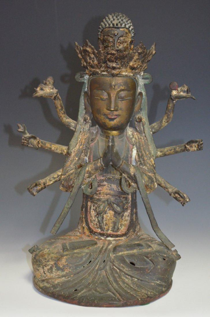 A Bronze Seated Multi-Armed Gold Gilt Buddha