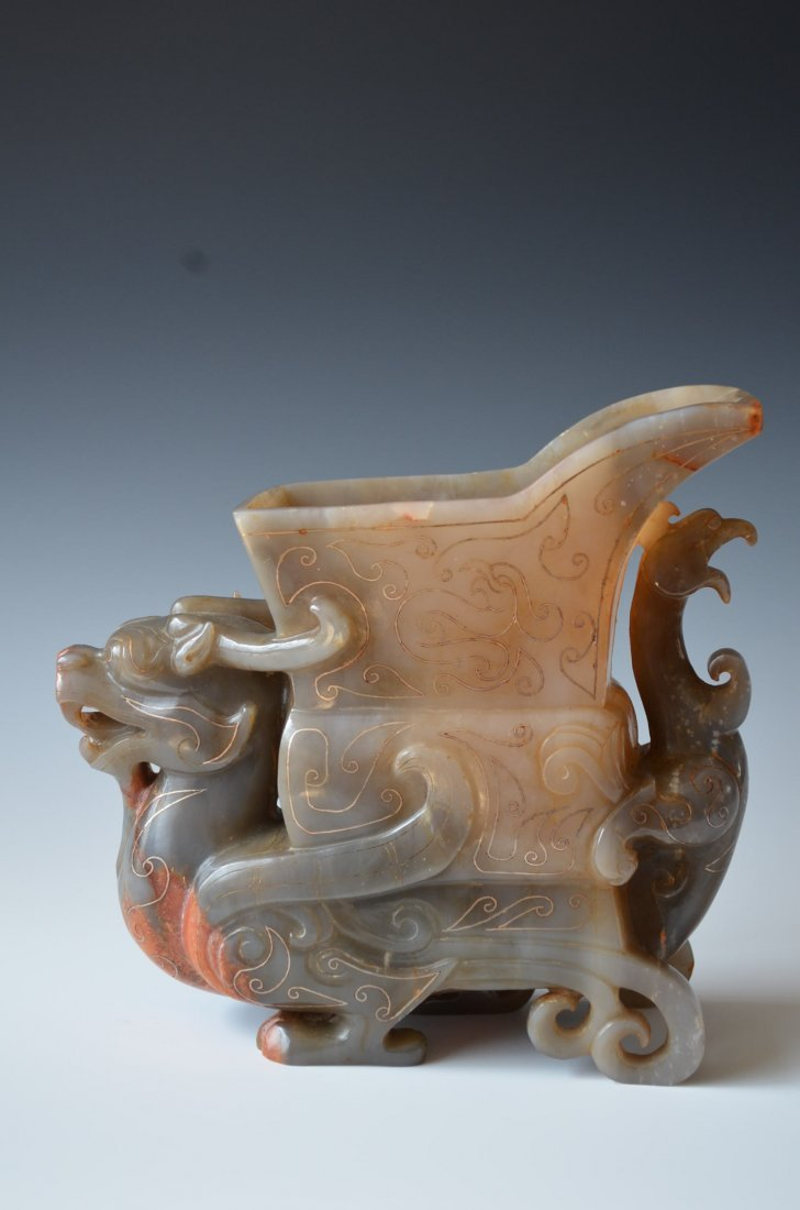 A Chinese Carved Jade Vessel with Chi Lin