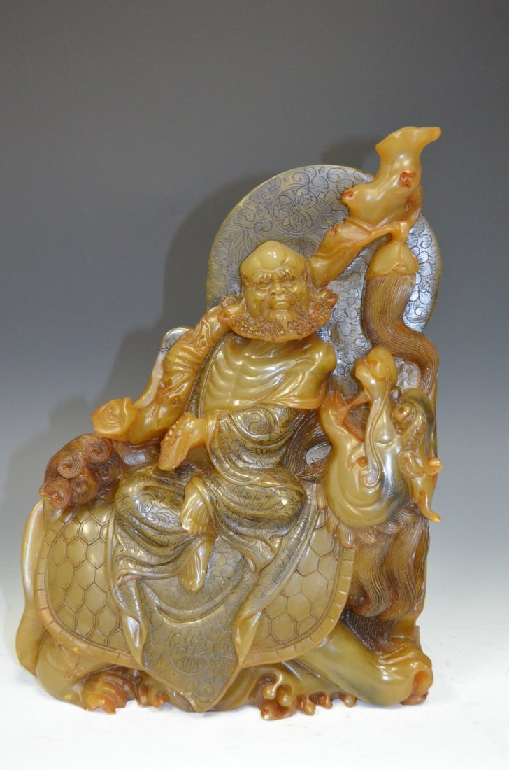 Carved Soapstone Model of A Lohan on Back of Chi Lin