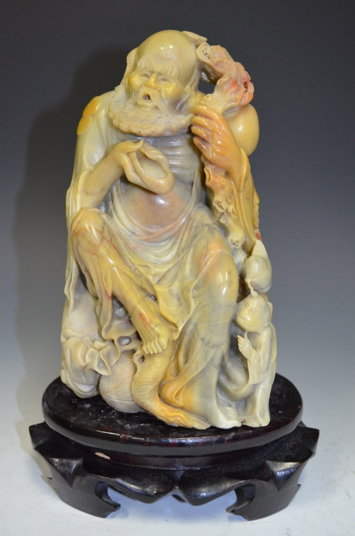 Carved Soapstone Model of A Lohan Seated on a Rock