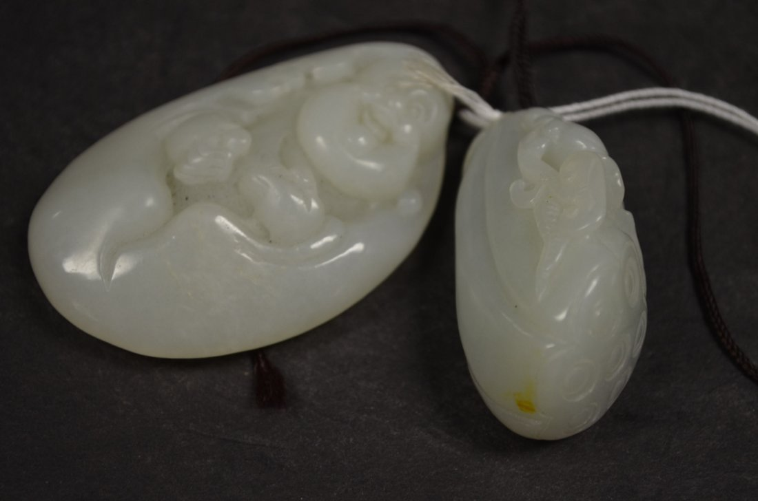 Two Carved White Jade Pendents