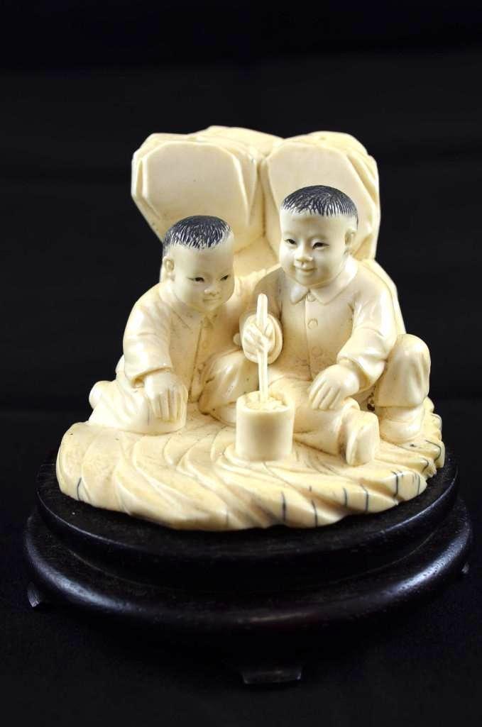 Carved Ivory of Ten Boys In A Rocky Landscape