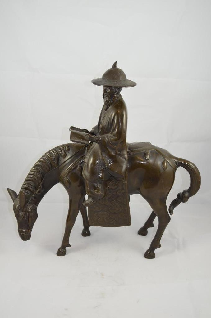 Bronze Scholar Riding on Horseback