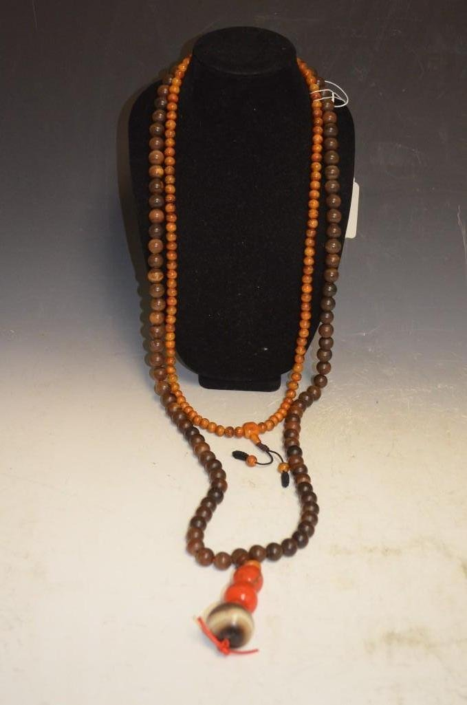 Two Chinese Carved Wood Beaded Necklaces