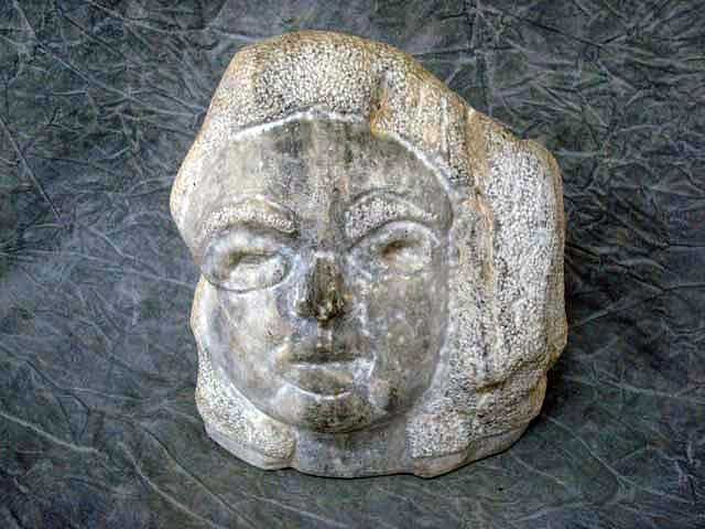 "18: Sculpture - Fieldstone,   ""woman's face"",  11"","
