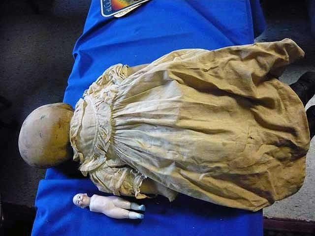 136: Early child's doll with cloth body and leather