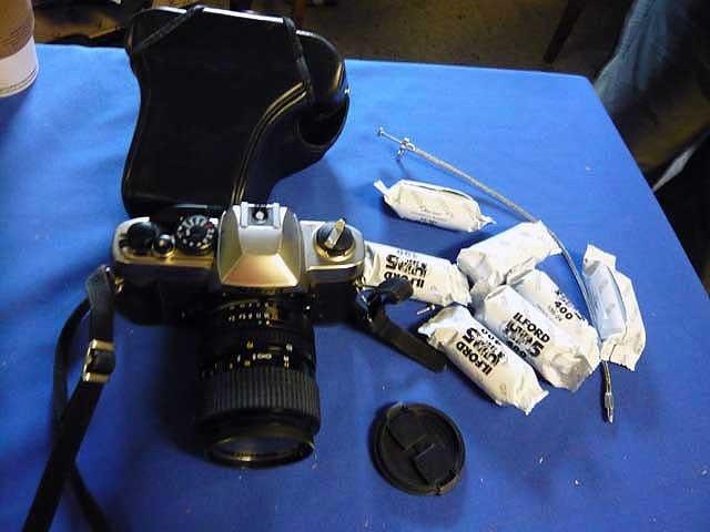 144: Nikon Camera, FM10 w/ film and case