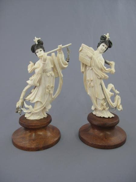 310: TWO CARVED IVORY FIGURES