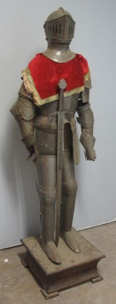 13: MINIATURE SUIT OF ARMOUR -with sword, on wooden arm