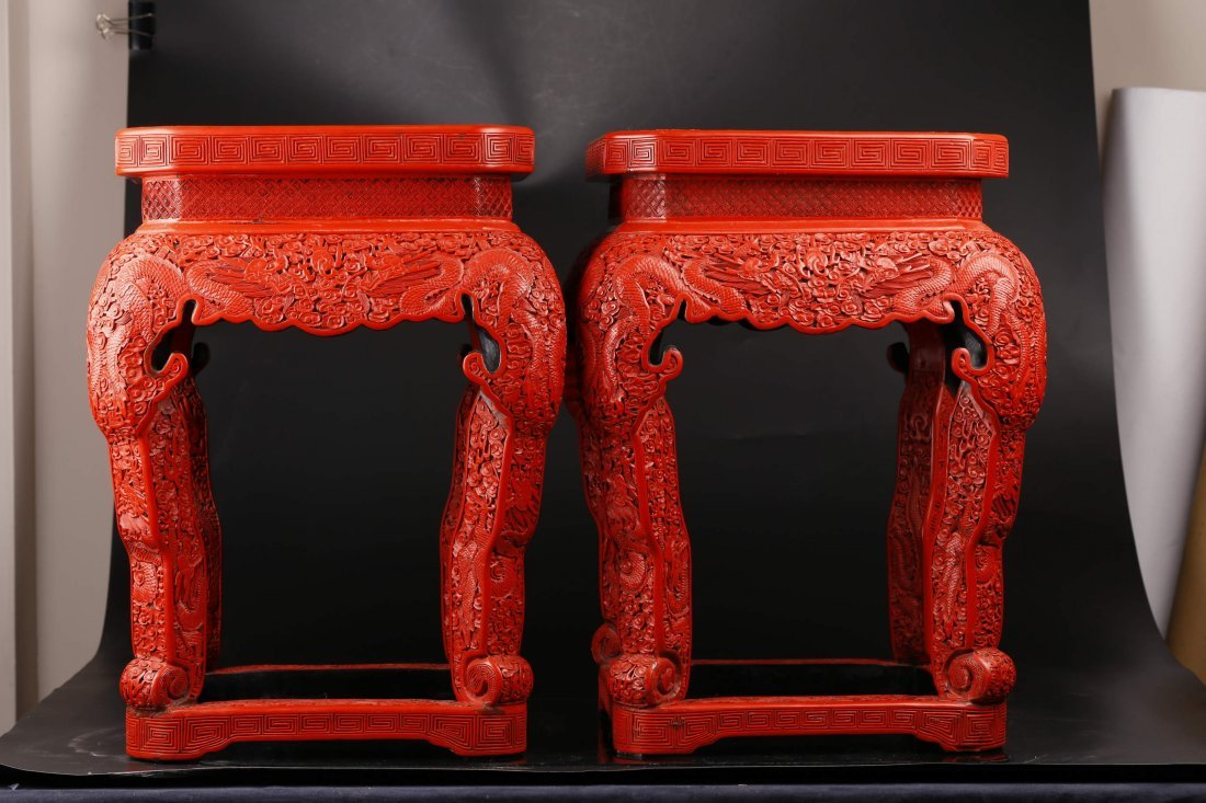 A Pair of Cinnabar Stools.