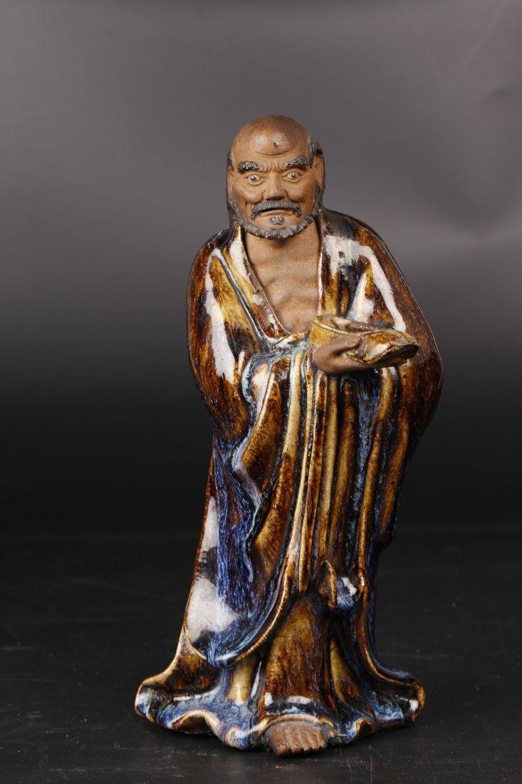 A Shi Wan Porcelain Sculpture.