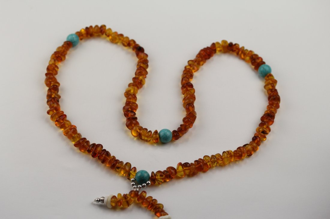 012: Antique amber Buddha beads