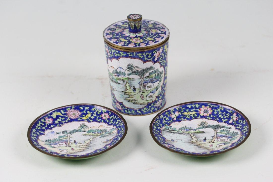 022: Oen of sate enamel bronze tea jar and two plates.