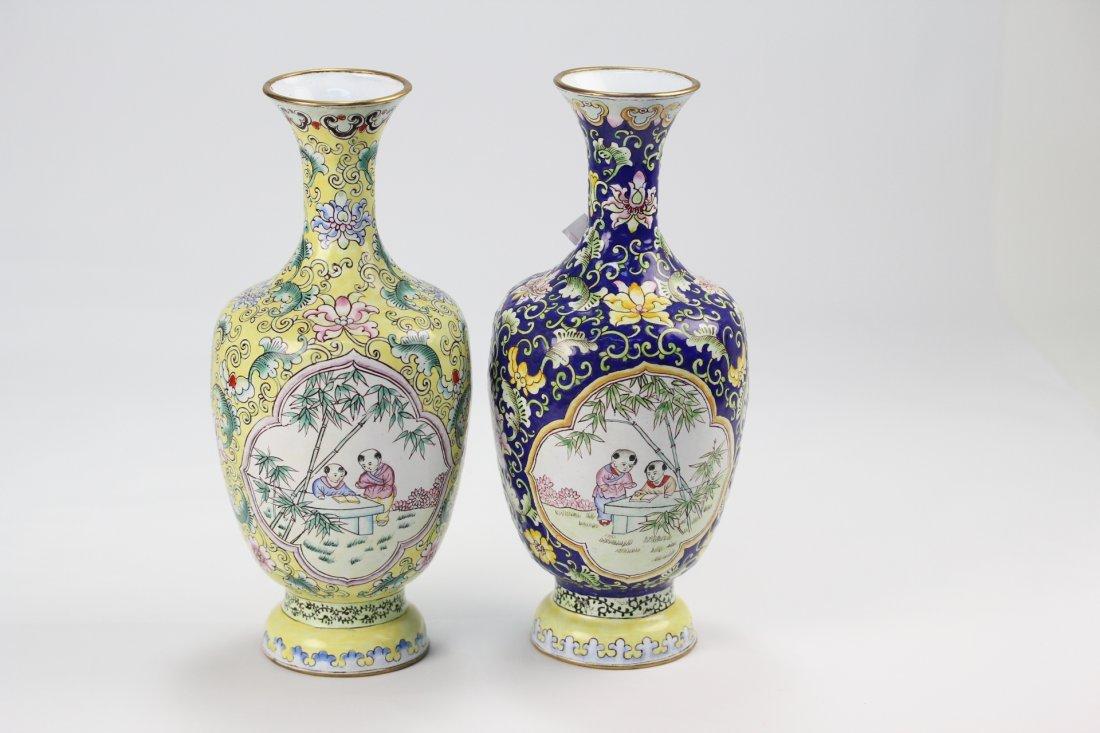 024:  pair of very fine old  enamel bronze vases