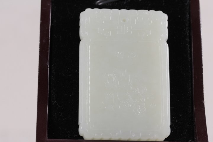 FINELY CARVED HOTIAN WHITE JADE PENDANT