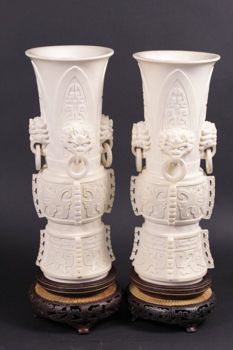 PAIR OF IVORY VASES  CARVED WITH FOUR LION HEADS