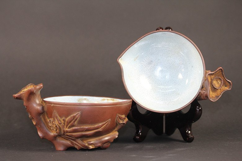PAIR OF PURPLE CLAY AND GLAZED CUPS