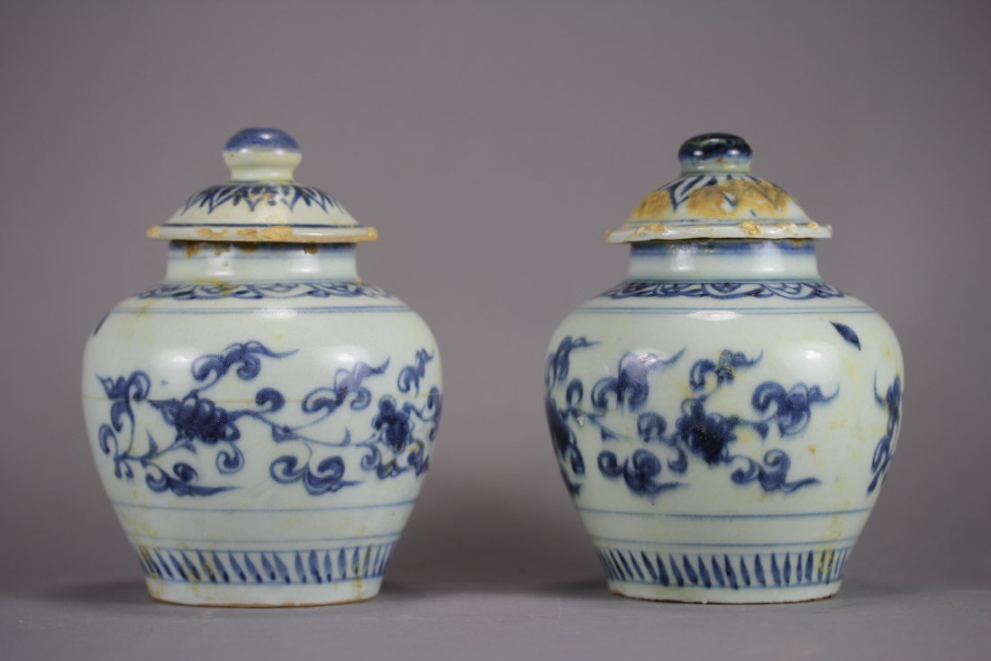 PAIR OF OLD BLUE AND WHITE COVERED JARS