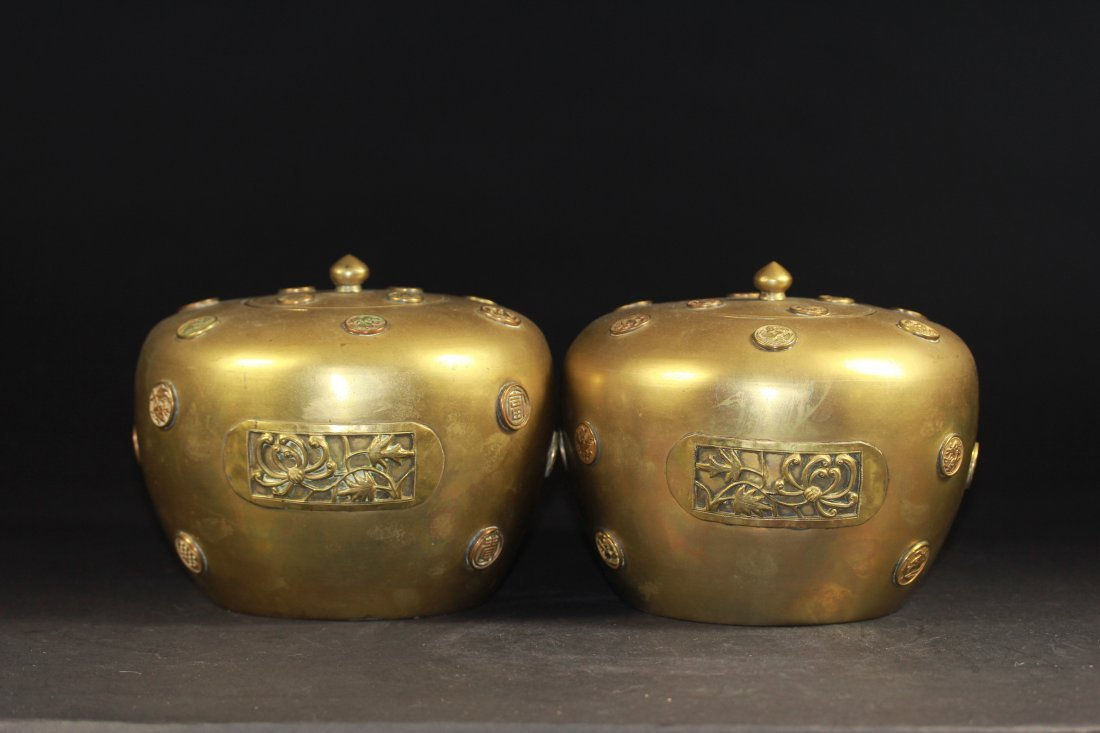 PAIR OF BRONZE ROUND LIDDED JARS.