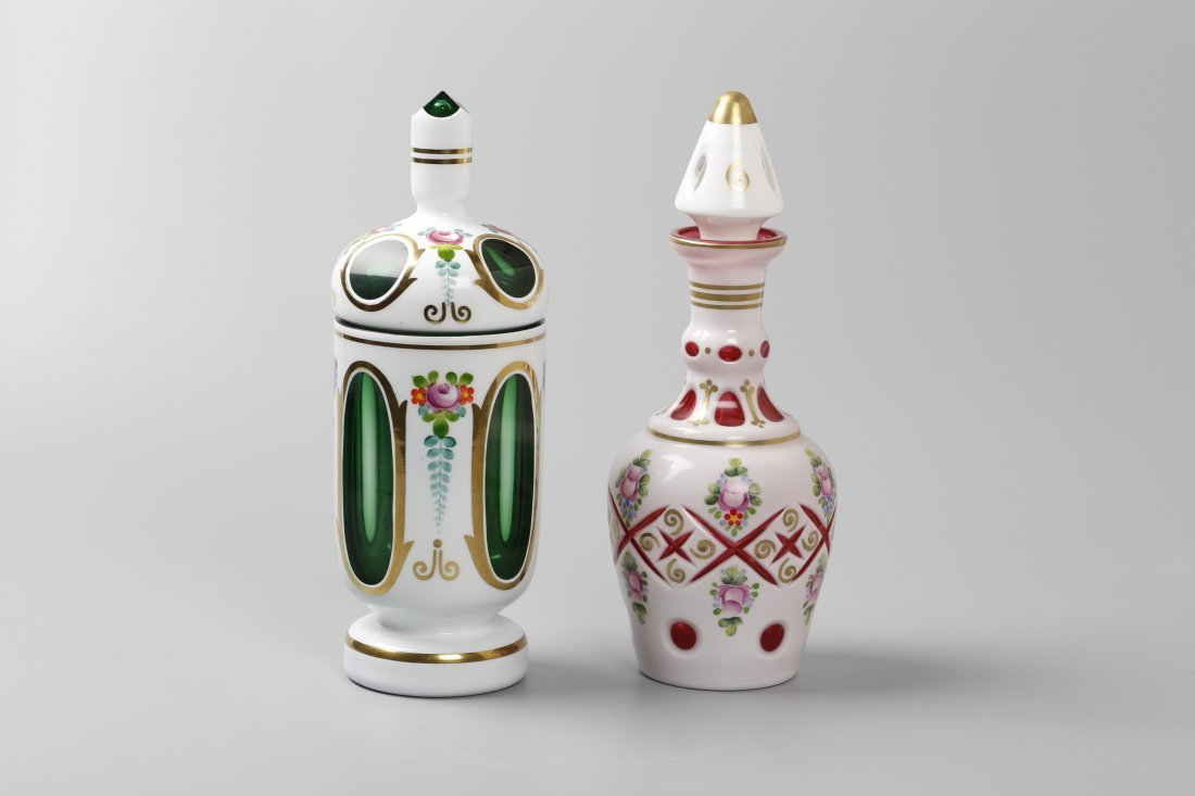Two Western Style Glass Overlay Bottles.