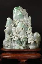 A Carved A Grade Jadeite Mountain With Base