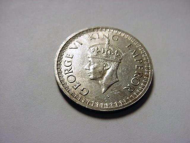 22: 1943 INDIA HALF RUPEE SILVER COIN
