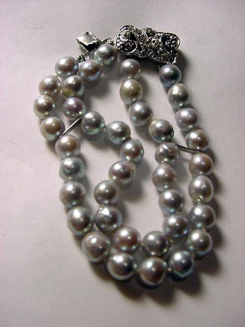 109: VINTAGE BAROQUE CULTURED PEARL DOUBLE STRAND BRACE