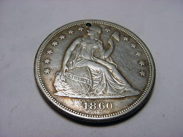 31: 1860-O SEATED LIBERTY DOLLAR [PIN HOLE]
