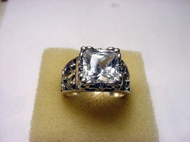 32: FANCY STERLING CZ RING SIZE 9