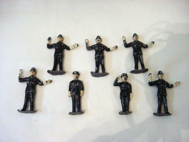21: [7] VINTAGE POLICE LEAD STATUES